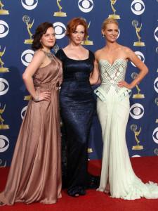 Elisabeth Moss with Christina Hendricks and January Jones at the 61st Primetime Emmy Awards