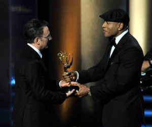 LL Cool J onstage presenting the Outstanding Supporting Actress In A Drama Series award to actor Michael Emerson during the 61st Primetime Emmy Awards