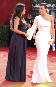 Kim Kardashian and Kourtney Kardashian arrive at the 61st Primetime Emmy Awards held at the Nokia Theatre on September 20th 2009 in Los Angeles