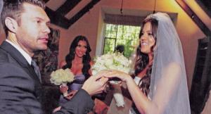 Khloe Kardashian wearing her wedding dress with Ryan Secrest and Kim Kardashian during her wedding ceremony on September 28th 2009