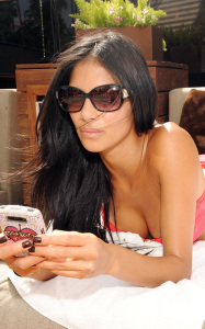 Nicole Scherzinger was spotted wearing a pink bikini at the Bare Pool Lounge party at the Mirage Hotel and Casino to celebrate the 20th anniversary of the resort on October 3rd 2009 2