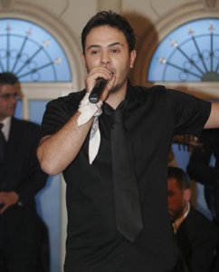 Ahmed Sherif picture while singing on stage in a black shirt