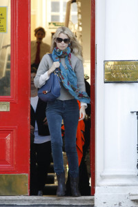 Claudia Schiffer spotted in dark denim skinny pants and brown leather boots while she drops her children off at school on October 12th 2009 1