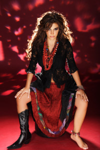 Lebanese singer Nelly Maqdesy photo at a studio session with a red atmosphere 7