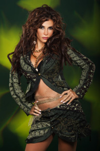 Lebanese singer Nelly Maqdesy photo wearing a mini skirt at a studio of a green background 6