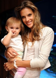 Alessandra Ambrosio spotted with her baby daughter Anja beside a fish tank in the lobby of their hotel in Miami on October 12th 2009 3