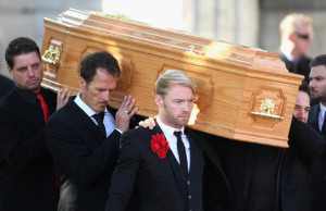 Keith Duffy and Ronan Keating carry out the coffin after the funeral of Boyzone singer Stephen Gately at St Laurence O'Toole Church on October 17th 2009 in Dublin Ireland