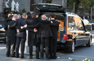 Ronan Keating, Mikey Graham, Shane Lynch and Keith Duffy look at coffin of Boyzone singer Stephen Gately at St Laurence O'Toole Church on October 17th 2009 in Dublin Ireland
