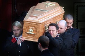 Mikey Graham, Ronan Keating, and Shane Lynch carry out the coffin of Boyzone singer Stephen Gately at St Laurence O'Toole Church on October 17th 2009 in Dublin Ireland