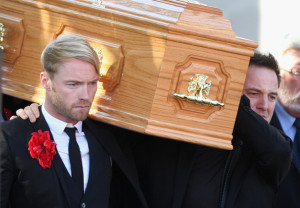 Mikey Graham and Ronan Keating carrying the coffin of Boyzone singer Stephen Gately at St Laurence O'Toole Church on October 17th 2009 in Dublin Ireland