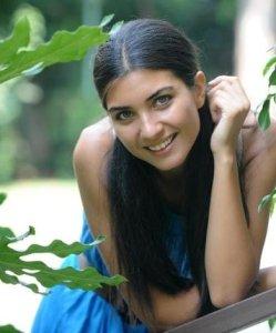 Tuba Buyukustun outdoor photo shoot wearing a blue dress 7