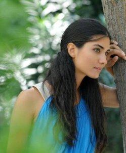 Tuba Buyukustun outdoor photo shoot wearing a blue dress 8