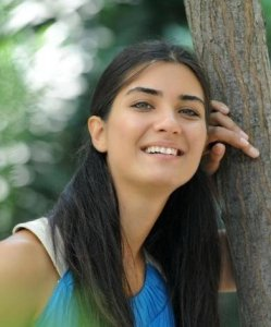 Tuba Buyukustun outdoor photo shoot wearing a blue dress 12