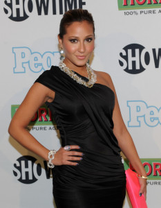 Adrienne Bailon attends the Bon Jovi When We Were Beautiful New York premiere at the SVA Theater on October 21st 2009 in New York City 4