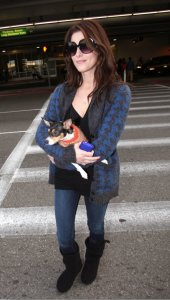Ashley Greene photo with her cute puppy as she was arriving at LAX in Los Angeles on December 28th 2009 3