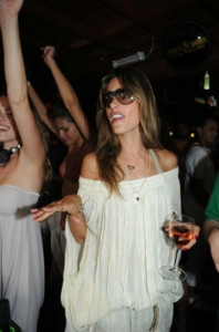 Alessandra Ambrosio photos at the Beach Cafe de la Musique on December 28th 2009 while wearing a white dress