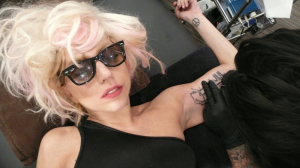 Lady Gaga photo shoot for the October 2009 issue of Interview Magazine while getting a new tattoo