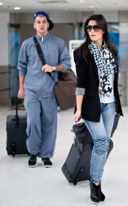 Kim Kardashian and her brother Rob spotted on January 14th 2010 at the Miami FL airport 4