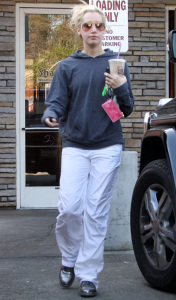 Ashley Tisdale stopping by Coffee Bean on December 29th 2009 in Toluca Lake wearing stylish sunglasses