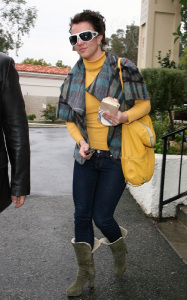 Britney Spears spotted heading to Starbucks in Calabasas California on January 26th 2010 wearing a yellow high neck top 2