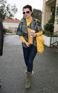Britney Spears spotted heading to Starbucks in Calabasas California on January 26th 2010 wearing a yellow high neck top 1