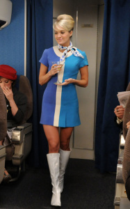 Carrie Underwood as a flight attendant on the set of How I Met Your Mother episode of January 2010 wearing a cute blue dress 2
