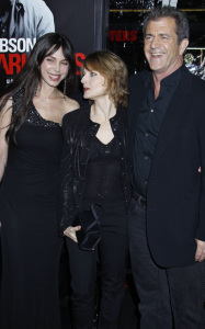 Jodie Foster along with Mel Gibson and Oksana Grigorieva at the Edge of Darkness premiere on January 26th 2010 at Graumans Chinese Theatre in Hollywood 1