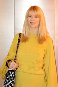 Claudia Schiffer spotted wearing a woolen yellow dress on January 26th 2010 while arriving at a Chanel Haute Couture Fashion show in Paris 1