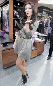 Kim Kardashian arrives at ShoeDazzle on January 29th 2010 at the Westfield Century City Shopping Mall wearing a cute silver dress 4