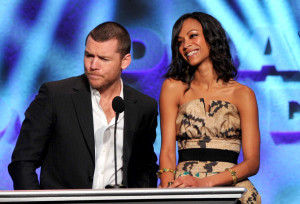 Sam Worthington and Zoe Saldana present the Feature Film Nomination Plaque for Avatar onstage during the 62nd Annual Directors Guild Of America Awards 2