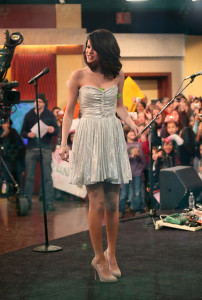 Selena Gomez picture while interviewed on Good Morning America on February 11th 2010 wearing a cute silver dress 2