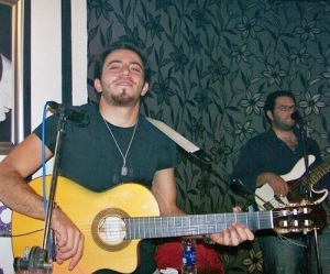 Basel Khoury picture while playing the guitar and performing on stage at a concert 2
