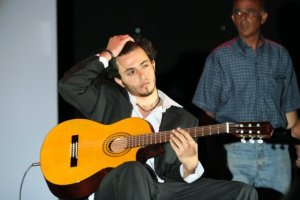 Basel Khoury picture while playing the guitar and performing on stage at a concert 22