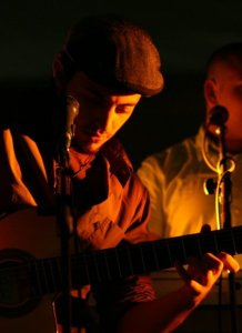 Basel Khoury picture while playing the guitar and performing on stage at a concert 27