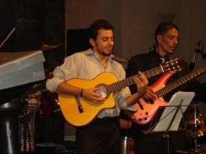 Basel Khoury picture while playing the guitar and performing on stage at a concert 34