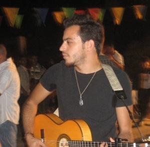 Basel Khoury picture while playing the guitar and performing on stage at a concert 15