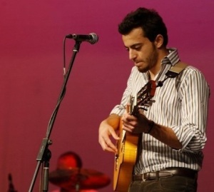 Basel Khoury picture while playing the guitar and performing on stage at a concert 40