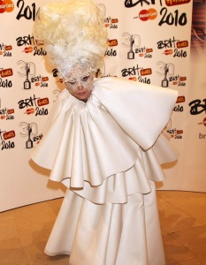 Lady Gaga wears a white layered dress as she arrives to The Brit Awards on February 16th 2010 at Earls Court in London England 4