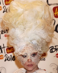 Lady Gaga wears a white layered dress as she arrives to The Brit Awards on February 16th 2010 at Earls Court in London England 1