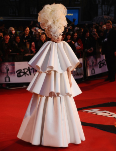 Lady Gaga wears a white layered dress as she arrives to The Brit Awards on February 16th 2010 at Earls Court in London England 2