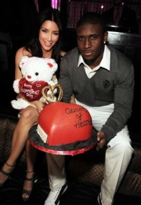 Kim Kardashian with her boyfriend Reggie Bush at The Queen Of Hearts Ball held on February 13th 2010 at LAVO in Las Vegas 6