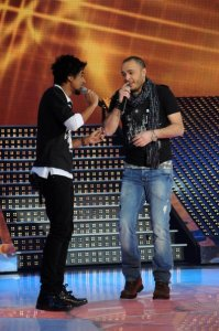 LBC Star Acdemy seven photo of the second prime on February 26th 2010 with the guest singer Ahmed Sherif from Tunis on stage singing with Sultan from Saudi Arabia