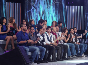 picture of the second prime of Star Academy 7 on February 26th 2010 while The 21 students sitting together at the side of the stage