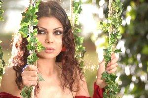 Haifa Wehbe desktop Wallpaper wearing a red dress at a garden like scene 1