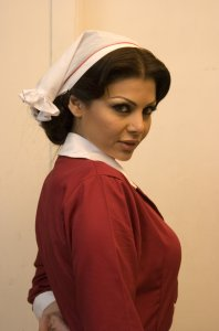 Haifa Wehbe large size photo wearing a red nurse outfit 5