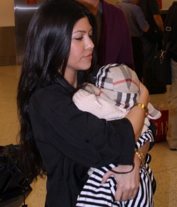 Kourtney Kardashian seen on March 2nd 2010 as she was arriving with her new born baby  at the Miami International Airport 1