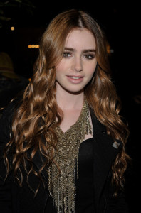 Lily Collins arrives at the Chanel And Charles Finch Pre Oscar Party Celebrating Fashion And Film at Madeo Restaurant on March 6th 2010 in Los Angeles 4