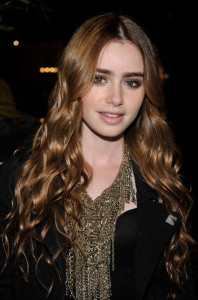 Lily Collins arrives at the Chanel And Charles Finch Pre Oscar Party Celebrating Fashion And Film at Madeo Restaurant on March 6th 2010 in Los Angeles 1