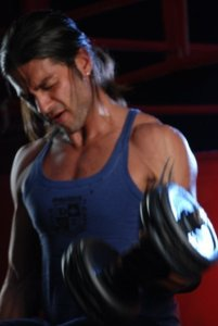 picture of Fadi Andrawos from his new video clip on March 2010 while on the filming set wearing a blue sleevless top 6