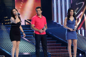 star academy fouth prime on March 12th 2010 picture of the three nominees basel from jordan with aline from lebanon and tahra from morocco singing on stage